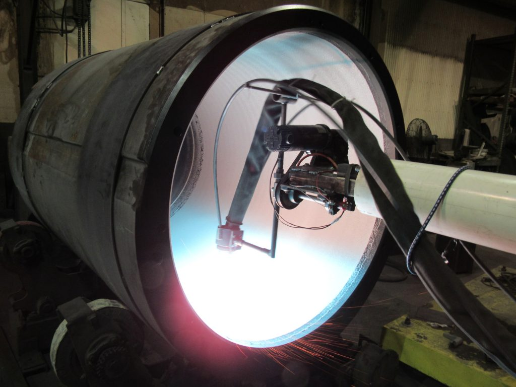 Spraying bore for limrstone processing using twin wire arc