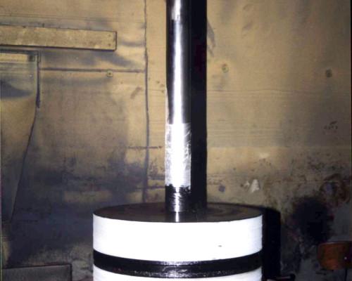 Compressor piston on rotary table