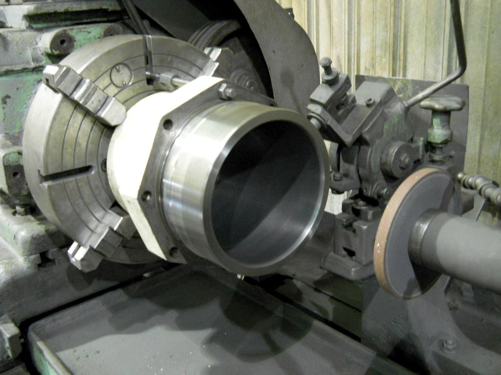 Bruderer press cylinder in grinder - ceramic coated and diamond ground