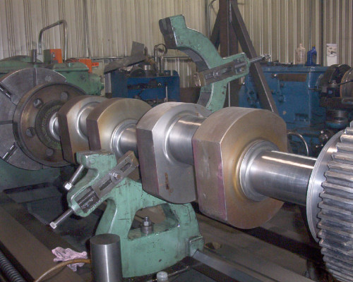 Punch-press crank on lathe - rebuilt main bearings