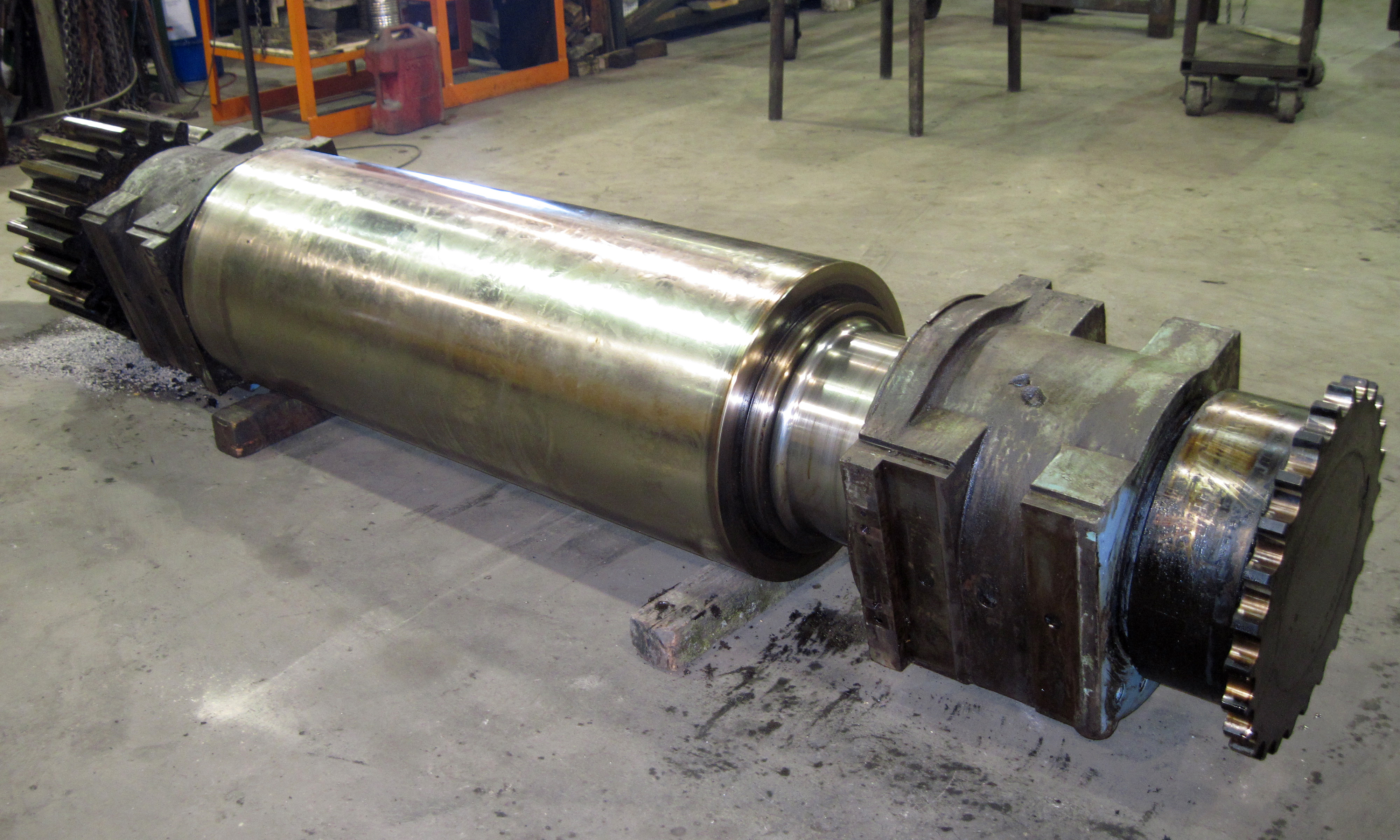 Rubber mill roll-repair bearing areas and replace bronze bearings and regrind face